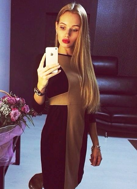 Olya Abramovich dark dress